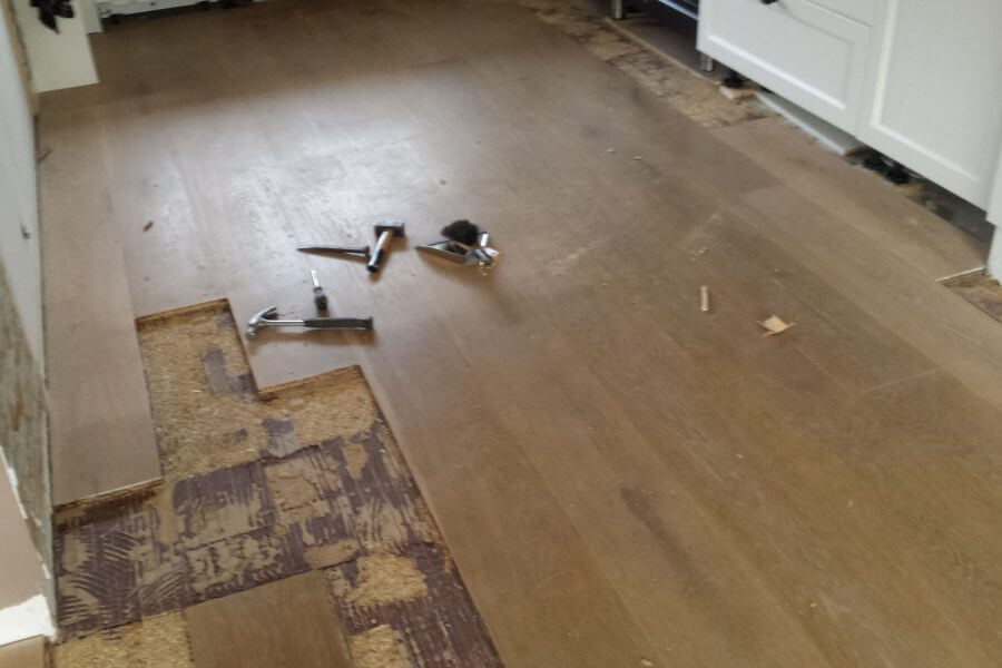 eiken houten vloer reparatie na waterschade