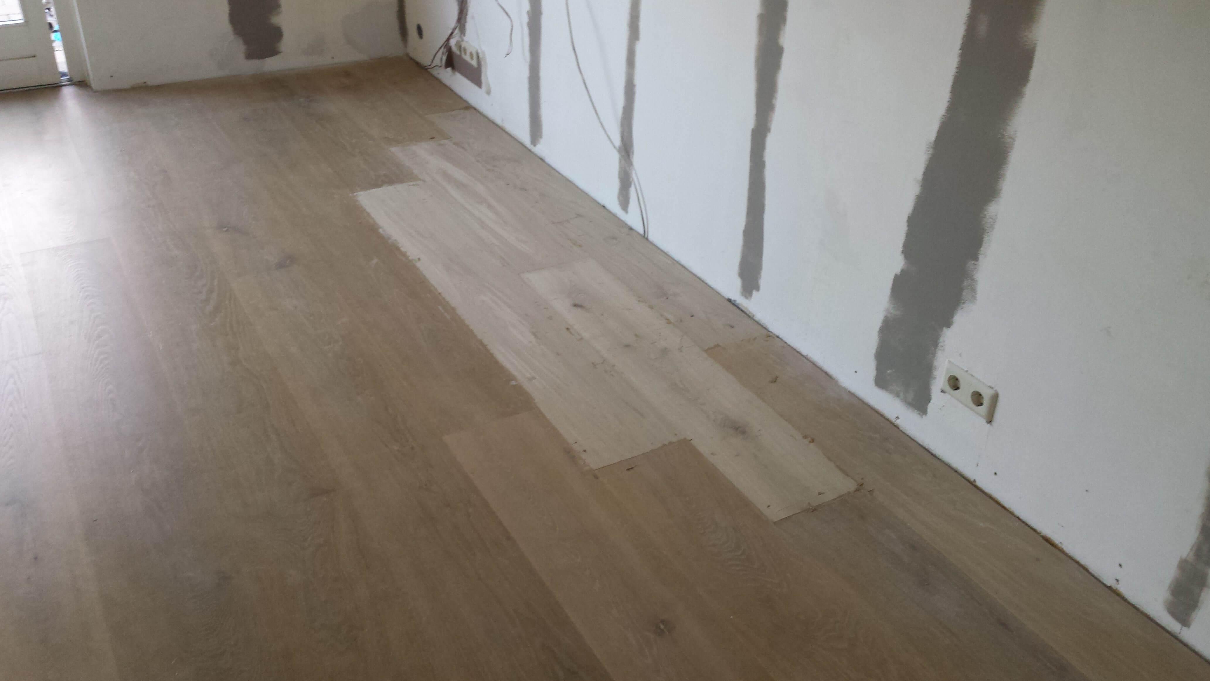 Repareren eiken houten vloer na water schade papendrecht